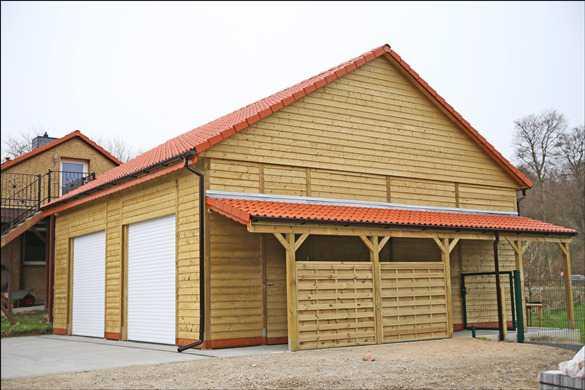 Doppelcarport riesig als Garage mit Sektionaltor und Satteldach