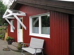 Vordach weiß mit Glas gefertigt nach Maß Kiel Rendsburg Quickborn Ahrensburg