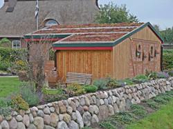 Fassade Gründach Satteldach Holz