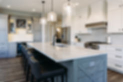 dk homes, white kitchen, quartz countertop, black faucet, subway tile, custom hood, stainless appliances, stained cabinets