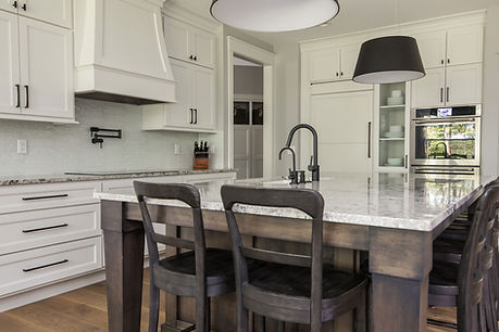 White Kitchen with stained island and large pendant lights