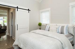 Master bedroom with sliding barn door