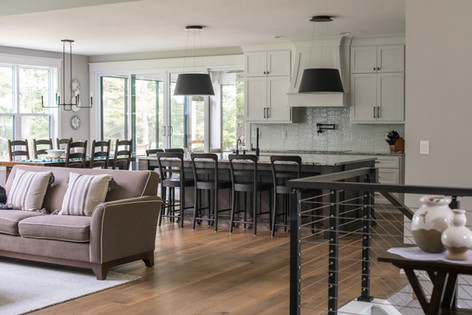 Custom Cabinetry, Wood Floors, Metal Railing