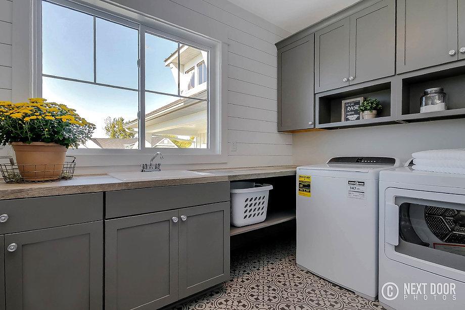 dk homes, shiplap, gray cabinets, laundry room