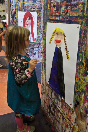 Young girl painting in a studio.