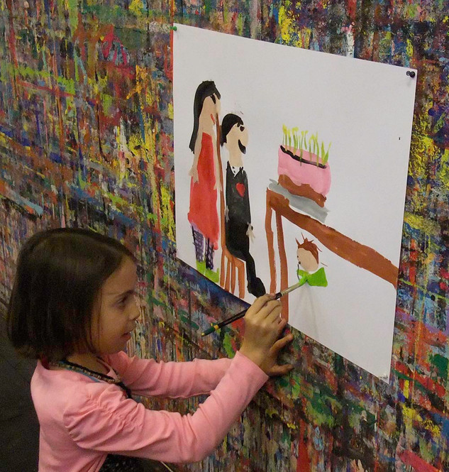 Girl painting a scene