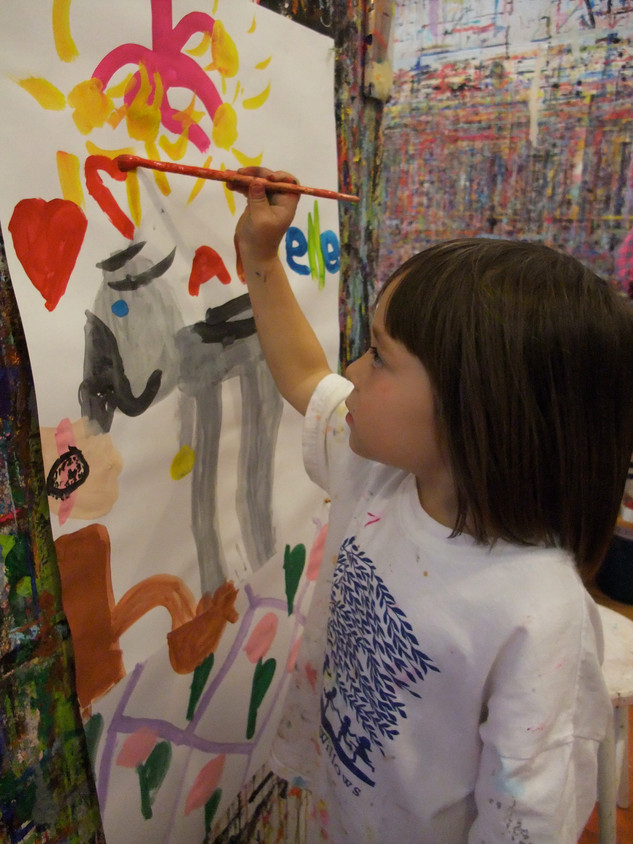 Young girl painting with color