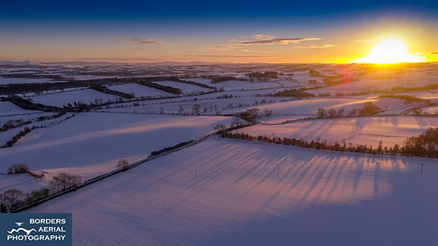 Aerial sunset from Bowden in the snow, Scottish Borders