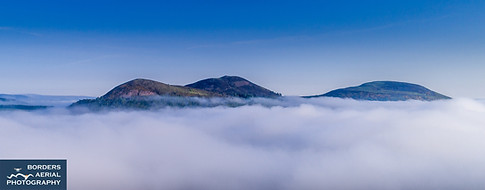 Drone shot of the iconic Eildon Hills above the mist, Scottish Borders
