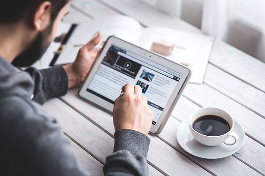 blog, man reading news on tablet, news, breakig news, solar blog, solar news, solar articles