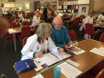 Inside the clubhouse working out the results as a match comes towards the end