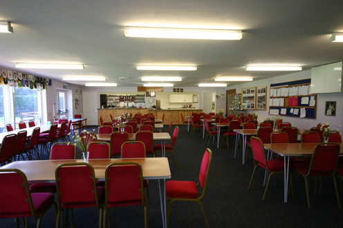 Clubhouse ready for after the match.  Fully equipped bar and kitchens. Seating for up to 100 people.  Panoramic view of the green.