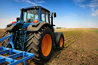 Huge tractor in the field - In a nice bl