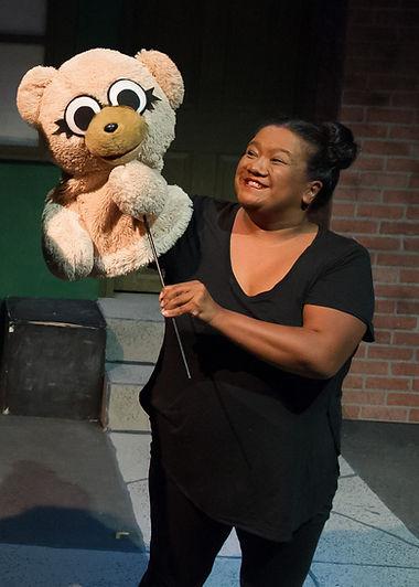 Jade A. Tiller performing Bad Idea Bear in Avenue Q at StageDoor Theatre