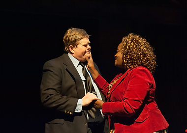 Sweet moment between Mark Disette and Lisa Young in The Full Monty at StageDoor Theatre