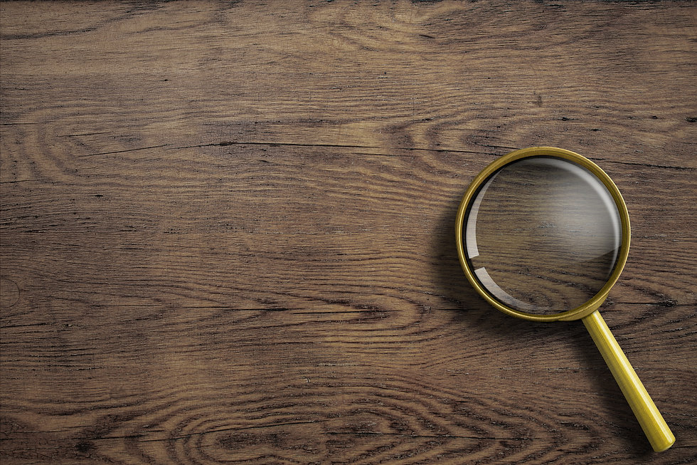 magnifying glass or loupe on wooden tabl