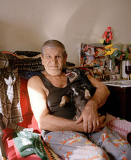 Con and Chichi, 2019, digital image [print on demand]  Con was a boxing trainer from Rome. His son was murdered 11 years ago and his daughter who was a lawyer developed a mental disorder shortly after. He only had Chi-Chi as accompany when I photograph him. Sadly, Chi-Chi passed away not long after.