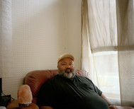 Ronny, 2019, digital image [print on demand]  Ronny lives alone in his house in Bourke Street. He likes to collect all different kinds of things from old CDs to golf clubs. He recently picked up some photographic lighting from the street and wanted to sell them, but neither of us knows how much they worth.