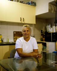 Faith, 2019, digital image [print on demand]  Faith is an indigenous activist who fights for the rights of aboriginal & Torres strait islanders, as well as the minorities in Australia. We had a few cigarettes together in her backyard and she shared some of her bitter past about being both a woman and aboriginal. I photographed her in her living room.