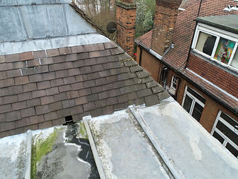 drone aerial view of damaged roof
