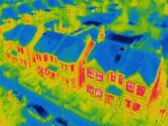 Drone aerial view of houses through drone thermal camera