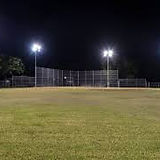 Empty baseball field at night.jpg