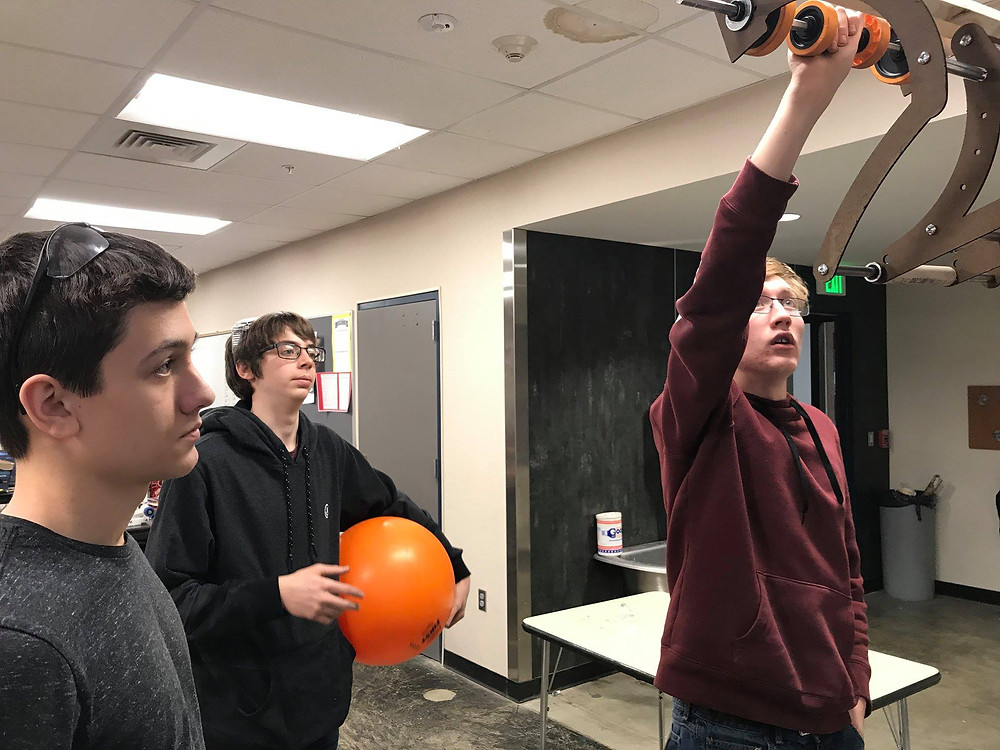 Tristan, Braylen and Jordan getting a better view of their intake prototype