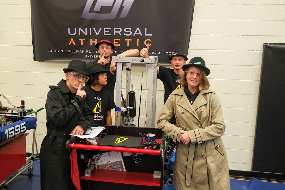 The Confidential drive team posing with their lovely robot, Flip