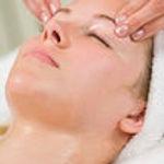 woman-gets-relaxing-head-massage-facial-