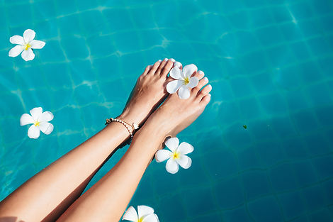 Beautiful female foot in swimming pool b