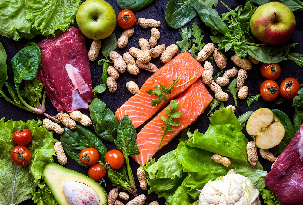 healthy-foods-salmon-apples-peanuts-avocado-tomatoes-spinach