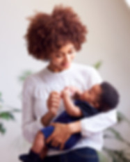Loving Mother Holding Newborn Baby At Ho