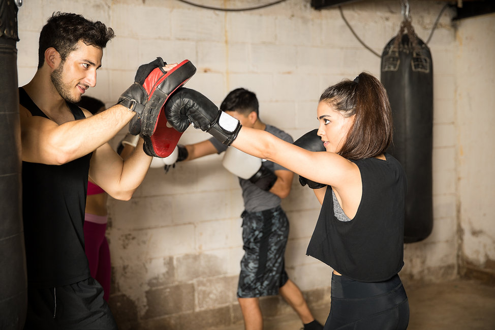 Group of people practicing their punches