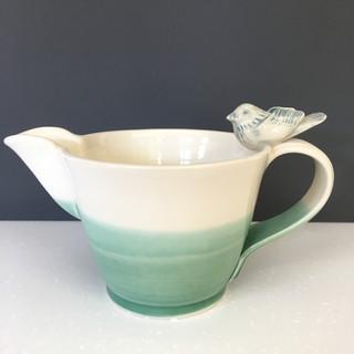Thrown jug with bird