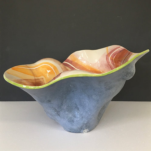 Large thrown and altered open vessel with orange surface pattern