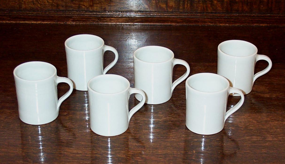 307-312  cups & saucers.jpg