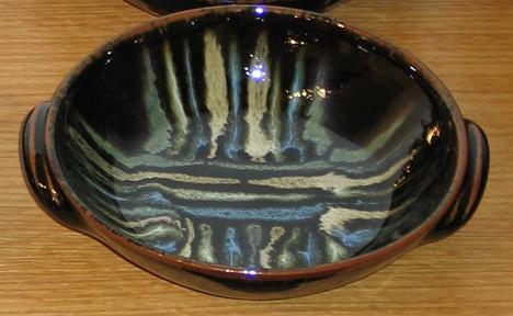 2005 handled dish crossed line pattern.J