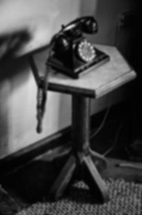 Rotary phone on hallway table