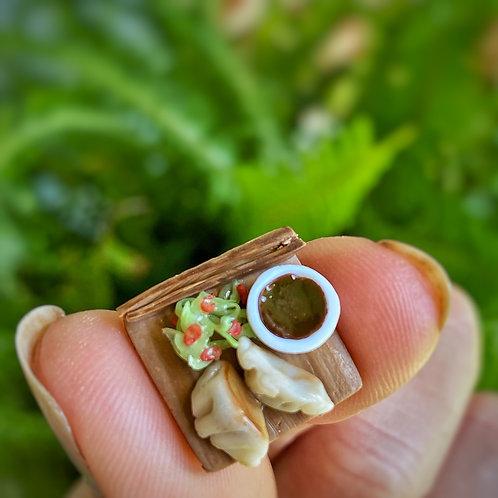 Gyoza with seaweed salad
