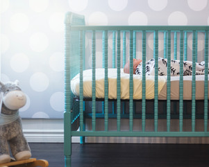 Newborn natural lifestyle photography session. Baby boy sleeping in his crib