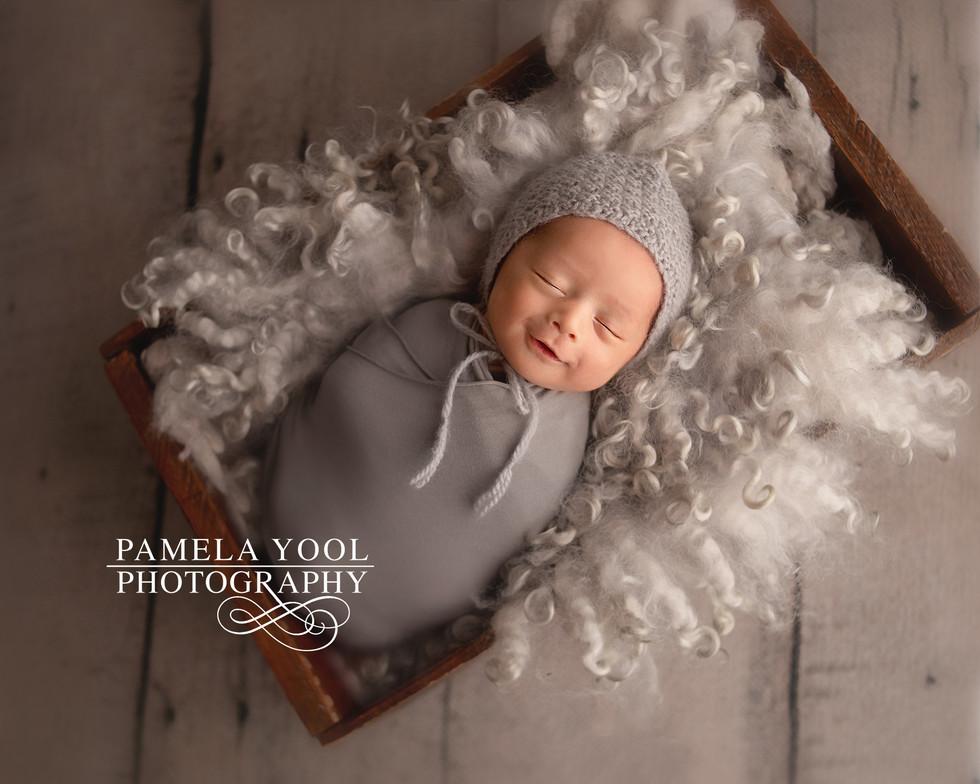 Newborn Baby Smiles Photo