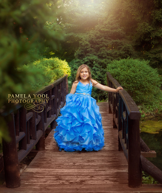Child photographer in Toronto Park. Princess dress in blue outdoor photography.