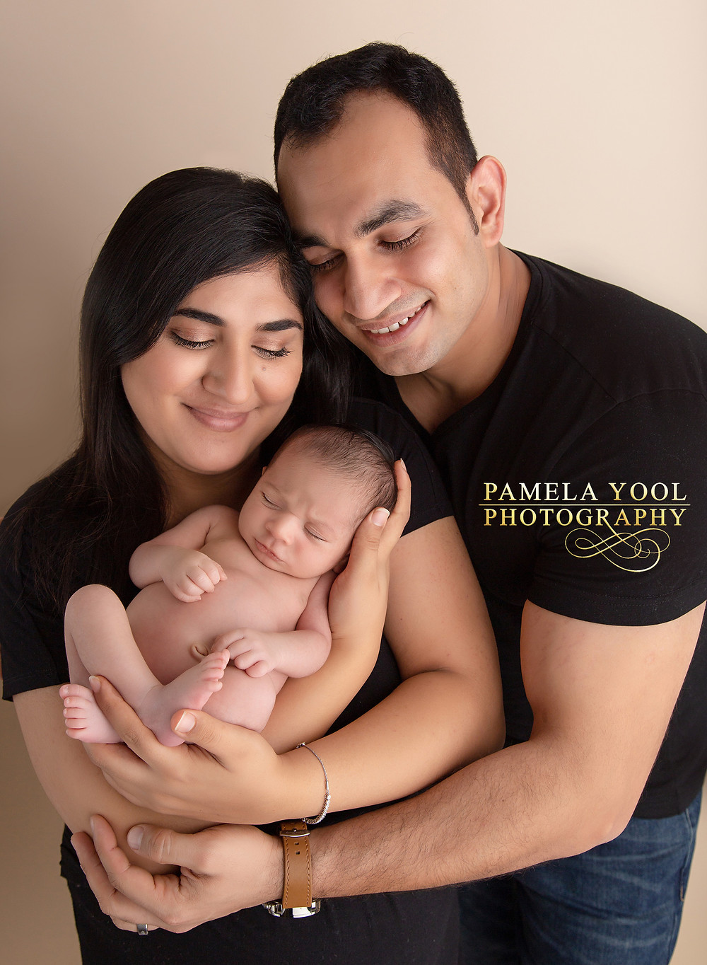 Newborn baby with parents photography