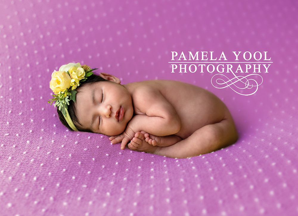 Newborn Photography -  Baby girl on lavender blanket