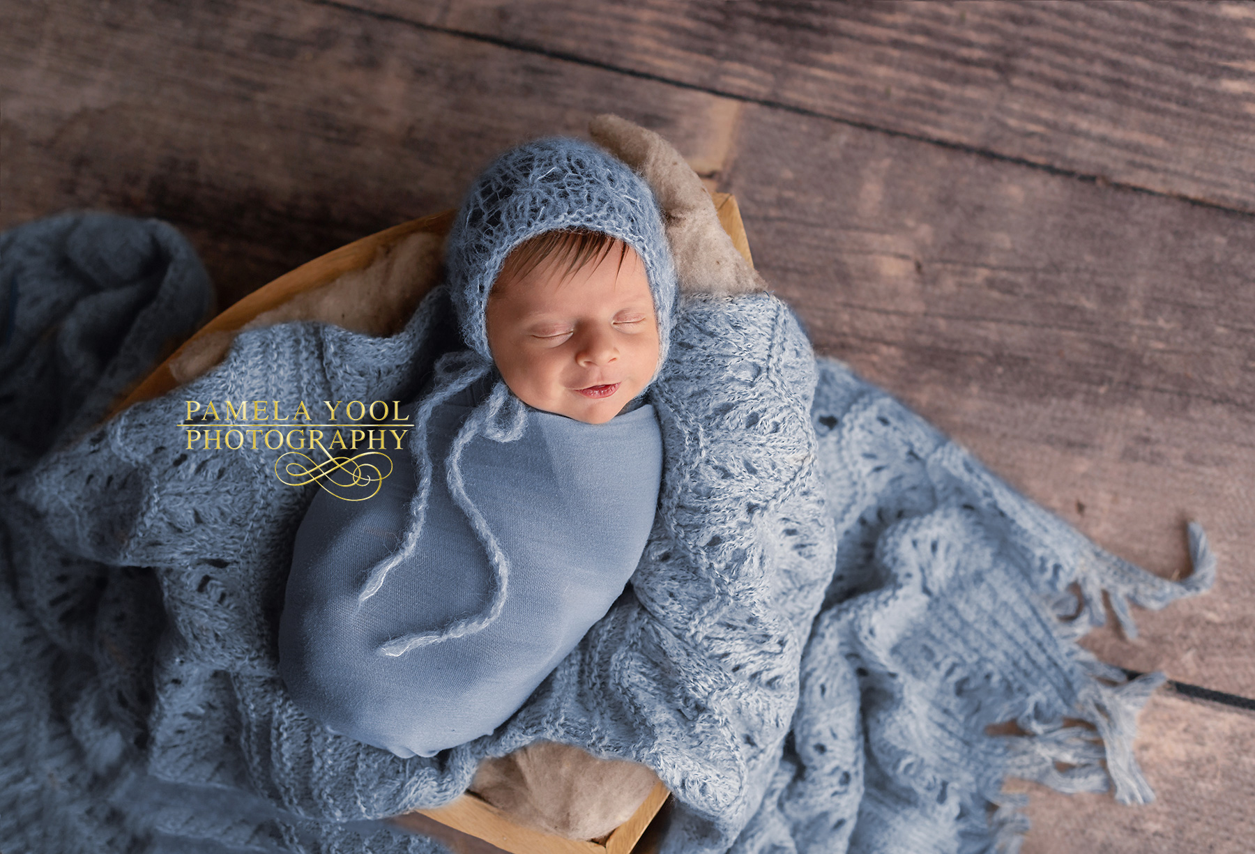 Smiling Newborn in Blue Original Pho