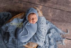 Smiling Newborn in Blue Original Pho
