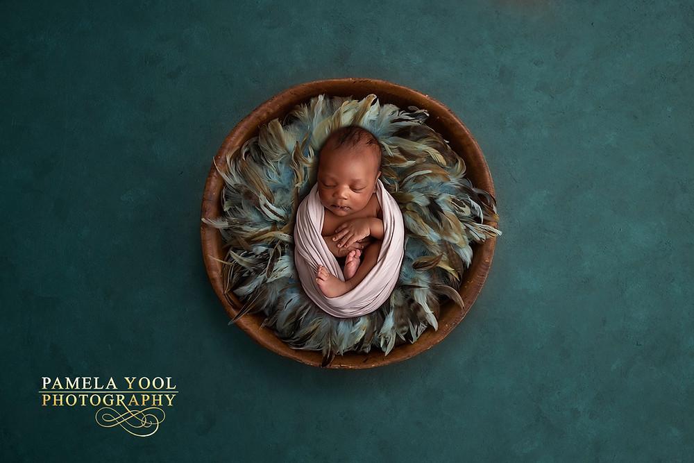 Gorgeous newborn in Teal