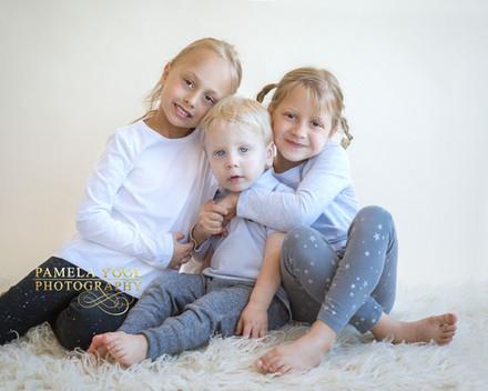 3 adorable siblings hugging - Toronto Family Photographer