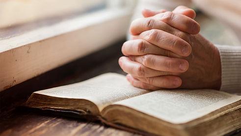 praying_hands_man_bible_0.jpg