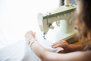 Womanusingsewingmachine-GettyImages-6114